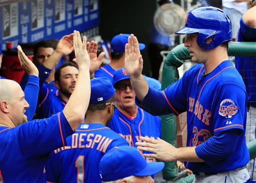 New York Mets' Matt Harvey, right, returns to the dugout after scoring from second on a double by Eric Young during the fifth inning of a baseball game against the Philadelphia Phillies, Sunday, June 23, 2013, in Philadelphia. (AP Photo/Tom Mihalek)