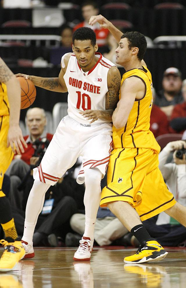 Ohio State's LaQuinton Ross (10) leans into Wyoming's Larry Nance, Jr. (22) during the second half of an NCAA college basketball game, Monday, Nov. 25, 2013, in Columbus, Ohio. (AP Photo/Mike Munden)