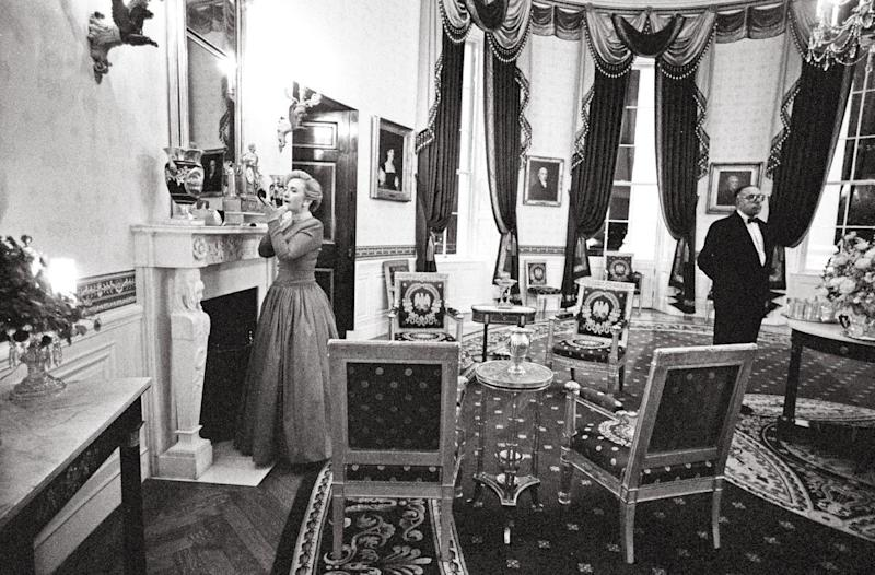 Hillary Clinton Does A Last Minute Touchup In The Blue Room Before 1996 National Governors Ociation Dinner As Longtime Butler James Jeffries Stands