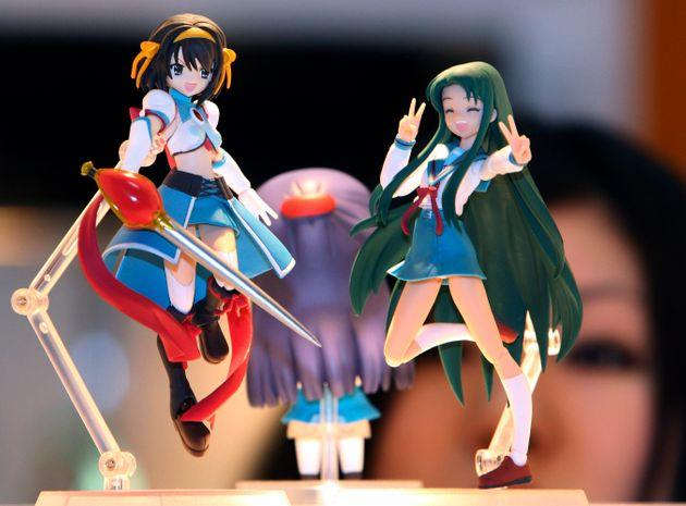 The studio is known for a host of famous characters, including Suzumiya Haruhi, left, seen here at an anime fair in Tokyo.