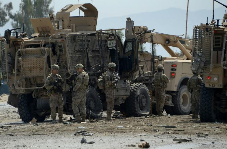 A partial truce in Afghanistan could be a step towards the withdrawal of US troops, seen here at the site of a suicide bomb attack in 2015