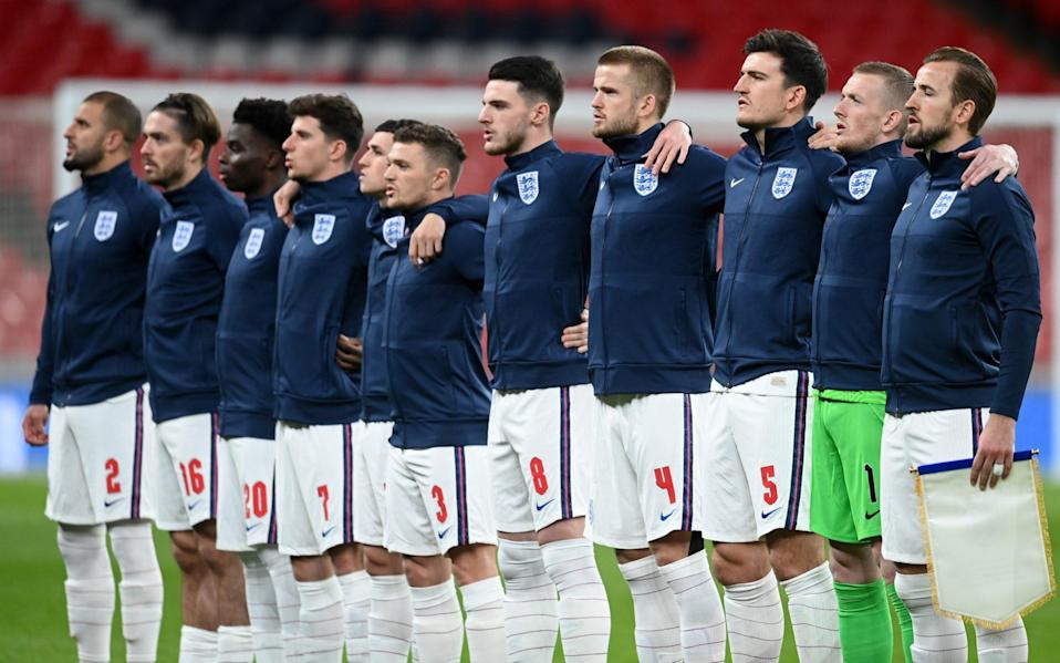 The England team line up for the national anthem prior to the UEFA Nations League group stage match between England and Iceland - Getty Images