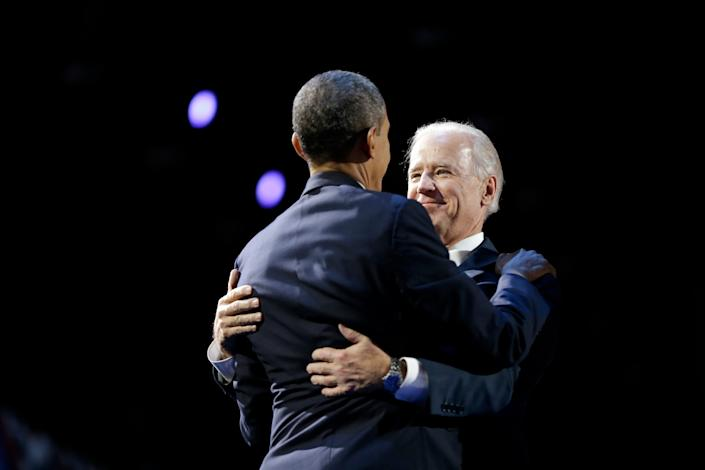 President Barack Obama and Vice President Joe Biden embrace on stage during an election night party, Wednesday, Nov. 7, 2012, in Chicago. Obama defeated Republican challenger former Massachusetts Gov. Mitt Romney.(AP Photo/Matt Rourke)