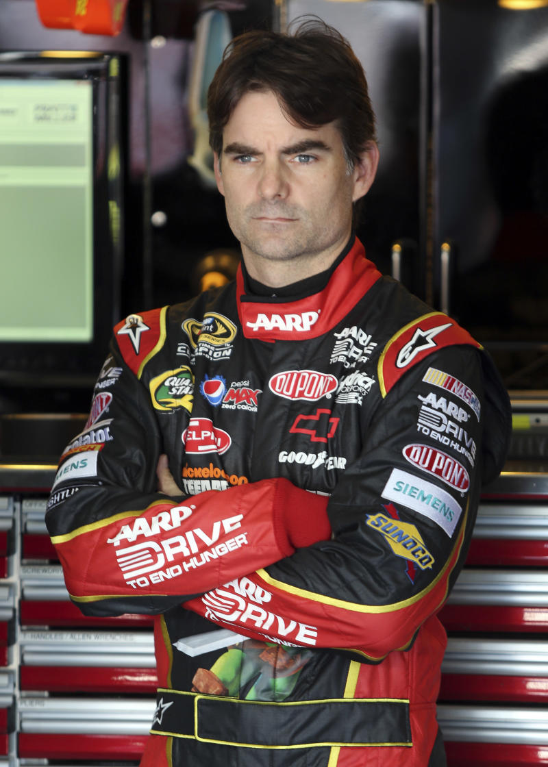FILE - In this Oct. 12, 2012 file photo, Jeff Gordon waits before practice for the NASCAR Bank of America 500 Sprint Cup series auto race in Concord, N.C. NASCAR has a real dilemma on its hands with this whole Gordon mess hanging over the season finale, Sunday, Nov. 18, 2012 at Homestead-Miami Speedway.  (AP Photo/Bob Jordan, File)