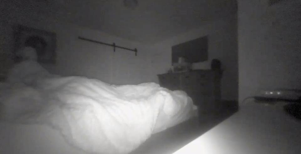A father complained about someone messing with his sheets at night, and his daughter shared the ghostly footage on social media. (Photo: Reddit)