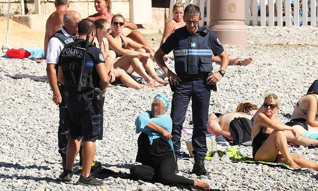 "<p>French police made waves on a beach in Nice after making a woman remove some of her clothing following a controversial ban on the burkini, a wetsuit-like garment that covers the head, shoulders and limbs. The mayor of Cannes, David Lisnard, called the garment ""a symbol of Islamic extremism"" and said that it was ""not respectful of good morals and secularism."" The ""burkini"" was banned in more than 30 French municipalities but was overturned on Aug. 26 by the French Council of State, France's highest administrative court, saying it was a violation of fundamental liberties. [Photo: Twitter] <br /></p><p>Read more <a rel=""nofollow"" href=""https://ca.style.yahoo.com/these-two-images-show-the-ridiculous-double-standards-women-face-when-it-comes-to-swimwear-2-195943747.html""><strong>here</strong>.</a></p><p></p>"