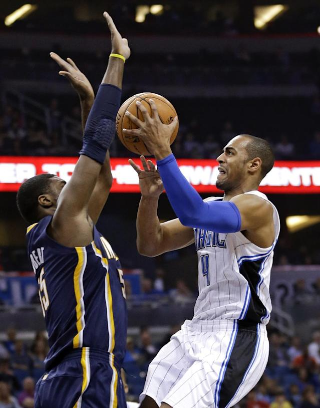 Orlando Magic's Arron Afflalo (4) takes a shot over Indiana Pacers' Roy Hibbert, left, during the first half of an NBA basketball game in Orlando, Fla., Sunday, Feb. 9, 2014. (AP Photo/John Raoux)