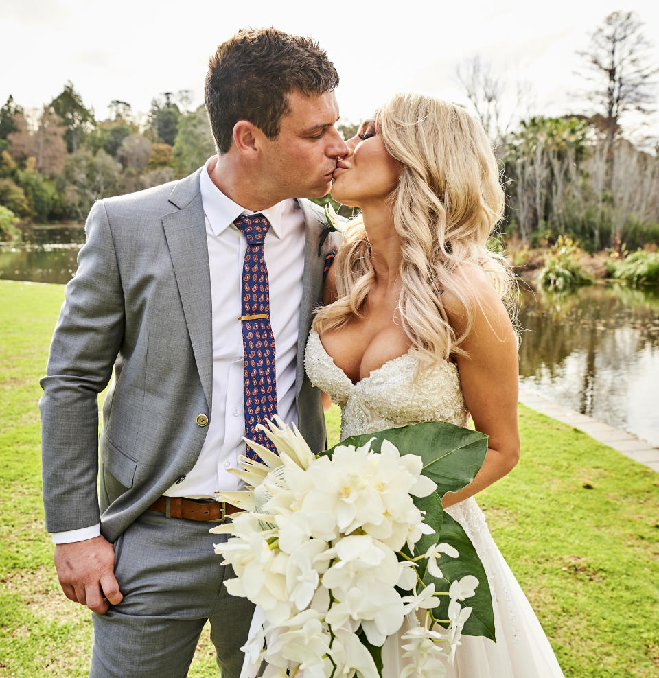 Married at First Sight Australia married couple Stacey and Michael embrace on wedding day