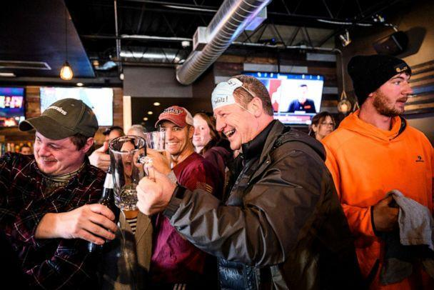 PHOTO: In this Dec. 16, 2020, file photo, a man lifts his drink with friends at the bar at Alibi Drinkery in Lakeville, Minn. (Star Tribune via Getty Images, FILE)