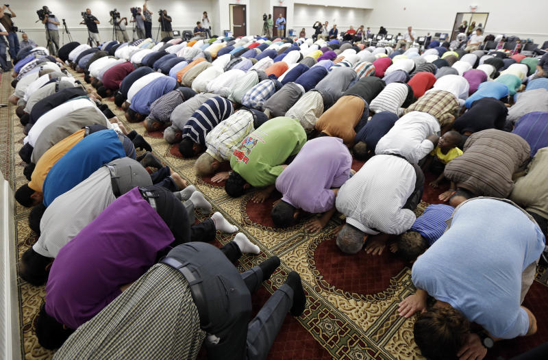Worshipers attend midday prayers at the Islamic Center of Murfreesboro on Friday, Aug. 10, 2012, in Murfreesboro, Tenn. Opponents of the mosque waged a two-year court battle trying to keep it from opening. (AP Photo/Mark Humphrey)