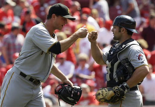 Pittsburgh Pirates relief pitcher Tony Watson is congratulated by catcher Michael McKenry, right, after they defeated the Cincinnati Reds 5-3 in a baseball game, Thursday, June 20, 2013, in Cincinnati. Watson recorded his second save of the season. (AP Photo/Al Behrman)