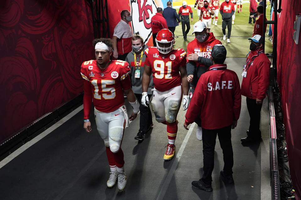 Kansas City Chiefs quarterback Patrick Mahomes (15) walks to the locker room following NFL Super Bowl 55 football game against the Tampa Bay Buccaneers Sunday, Feb. 7, 2021, in Tampa, Fla. The Buccaneers defeated the Chiefs 31-9 to win the Super Bowl. (AP Photo/David J. Phillip)