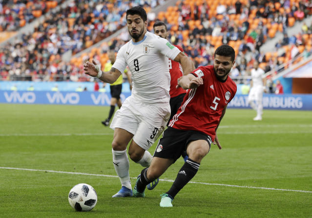 Uruguay's Luis Suarez, left, challenges for the ball with Egypt's Sam Morsy during the group A match between Egypt and Uruguay at the 2018 soccer World Cup in the Yekaterinburg Arena in Yekaterinburg, Russia, Friday, June 15, 2018. (AP Photo/Natacha Pisarenko)
