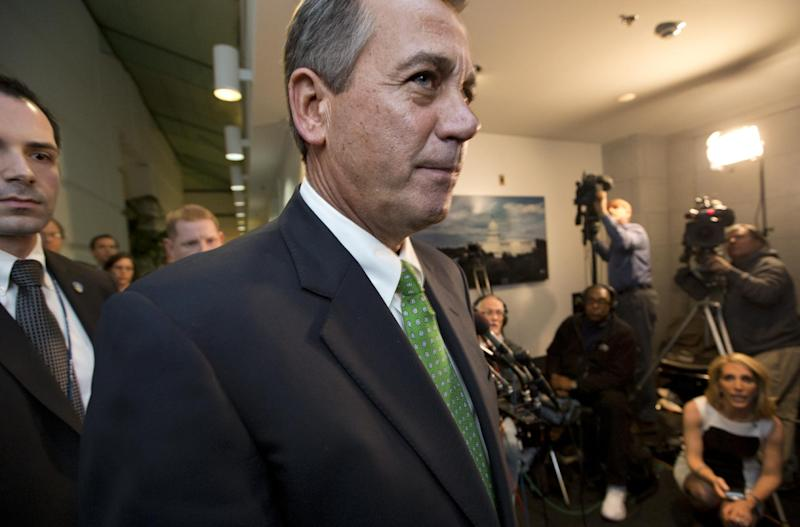 "Speaker of the House John Boehner, R-Ohio, passes waiting reporters as he leaves a closed-door GOP meeting on the ""fiscal cliff"" bill passed by the Senate Monday night, at the Capitol in Washington, Tuesday, Jan. 1, 2013.  (AP Photo/J. Scott Applewhite)"