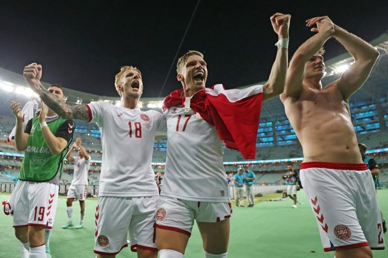 Denmark's players celebrate after taking another step towards emulating the team of 1992 and winning the European Championship