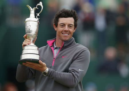 Rory McIlroy of Northern Ireland celebrates as he holds the Claret Jug after winning the British Open Championship at the Royal Liverpool Golf Club in Hoylake, northern England July 20, 2014. REUTERS/Cathal McNaughton