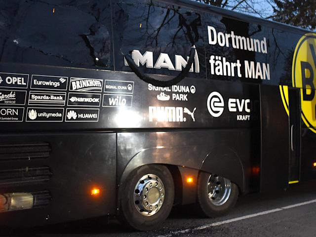 Dortmund bus attacked as explosions leave Marc Bartra injured and Monaco quarter-final postponed
