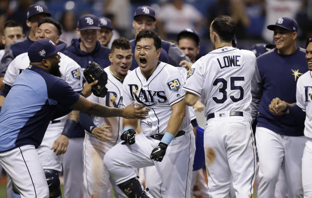 Tampa Bay Rays' Ji-Man Choi, of South Korea, center, celebrates his two-run walk-off home run off Cleveland Indians pitcher Brad Hand during the ninth inning of a baseball game Monday, Sept. 10, 2018, in St. Petersburg, Fla. (AP Photo/Chris O'Meara)