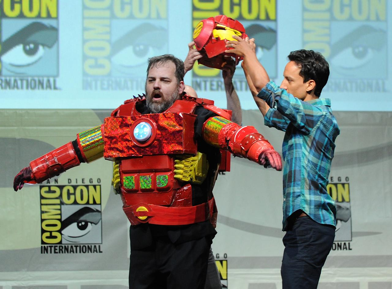 "SAN DIEGO, CA - JULY 21: Writer Dan Harmon (L) and actor Danny Pudi speak onstage at the ""Community"" celebrating the fans during Comic-Con International 2013 at San Diego Convention Center on July 21, 2013 in San Diego, California. (Photo by Kevin Winter/Getty Images)"