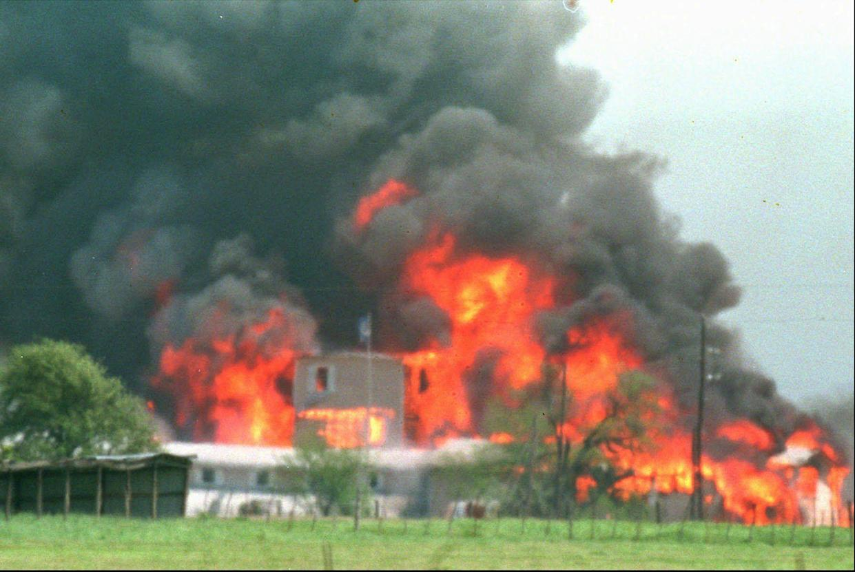 FILE- Fire engulfs the Branch Davidian compound near Waco, Texas, in this April 19, 1993 photo.
