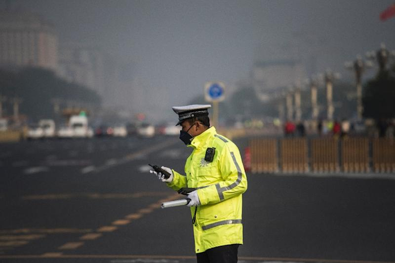 "China's national air quality forecasting system attributed the pollution to low atmospheric pressure and weak winds, with ""medium to heavy pollution"" forecast for Saturday in the region (AFP Photo/FRED DUFOUR)"