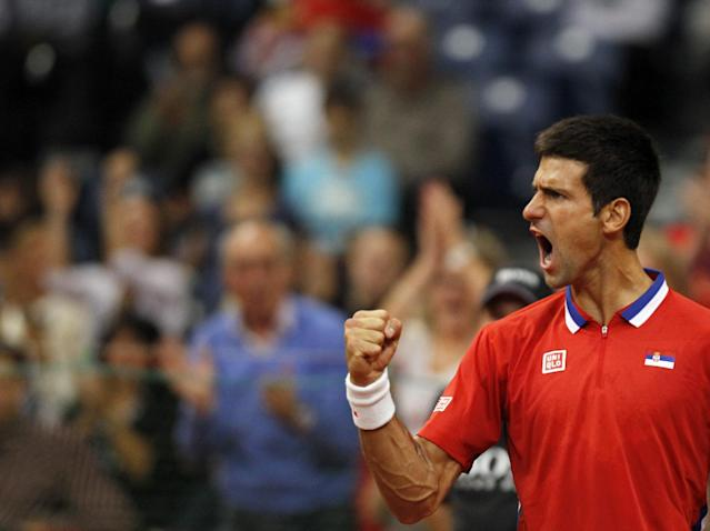 Novak Djokovic of Serbia celebrates a point won against Milos Raonic of Canada during their Davis Cup semifinal tennis match in Belgrade, Serbia, Sunday, Sept. 15, 2013. (AP Photo/Darko Vojinovic)