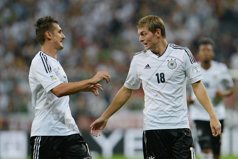 Germany's Toni Kroos,right, and Miroslav Klose celebrate after scoring during the FIFA World Cup 2014 qualification group C soccer match between Germany and Austria in Munich, southern Germany, on Friday, Sept.6, 2013. (AP Photo/ Kerstin Joensson)