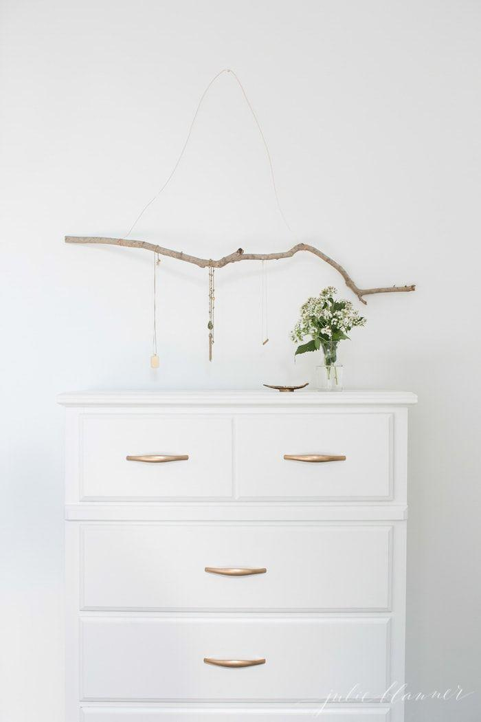 """<p>You're stuck inside so there's no excuse not to organize your jewelry finally! This simple branch project makes it easy to hang up your faves so you'll never have to dig through a tangled mess again.</p><p><strong>Get the tutorial at <a href=""""https://julieblanner.com/diy-jewelry-hanger/"""" rel=""""nofollow noopener"""" target=""""_blank"""" data-ylk=""""slk:Julie Blanner"""" class=""""link rapid-noclick-resp"""">Julie Blanner</a>.</strong></p><p><a class=""""link rapid-noclick-resp"""" href=""""https://www.amazon.com/Beadalon-Artistic-22-Gauge-Copper-15-Yards/dp/B003IUG1PM/ref=sr_1_6?dchild=1&keywords=copper+wire&qid=1600883809&s=home-garden&sr=1-6&tag=syn-yahoo-20&ascsubtag=%5Bartid%7C10050.g.23489557%5Bsrc%7Cyahoo-us"""" rel=""""nofollow noopener"""" target=""""_blank"""" data-ylk=""""slk:SHOP COPPER WIRE"""">SHOP COPPER WIRE</a></p>"""