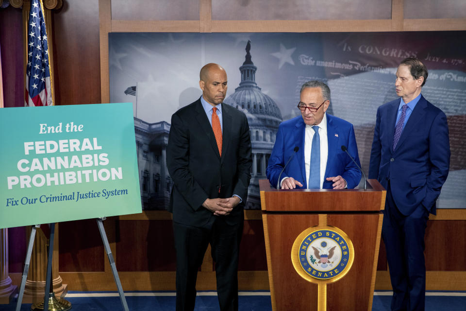 From left, Sen. Cory Booker, D-N.J.,Senate Majority Leader Chuck Schumer, D-N.Y., and Sen. Ron Wyden, D-Ore., announce a draft bill that would decriminalize marijuana on a federal level Capitol Hill in Washington, on Wednesday, July 14, 2021. The bill, called the Cannabis Administration and Opportunity Act, would not only decriminalize marijuana, but also expunge the records of those with non-violent convictions related to cannabis and invest money into restorative justice programs. (AP Photo/Amanda Andrade-Rhoades)