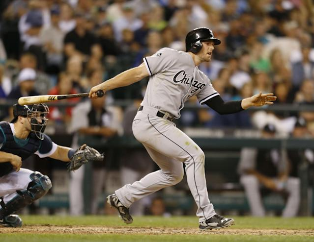 Chicago White Sox's Conor Gillaspie watches his RBI single against the Seattle Mariners during the 10th inning of a baseball game in Seattle on Saturday, Aug. 9, 2014. (AP Photo/John Froschauer)