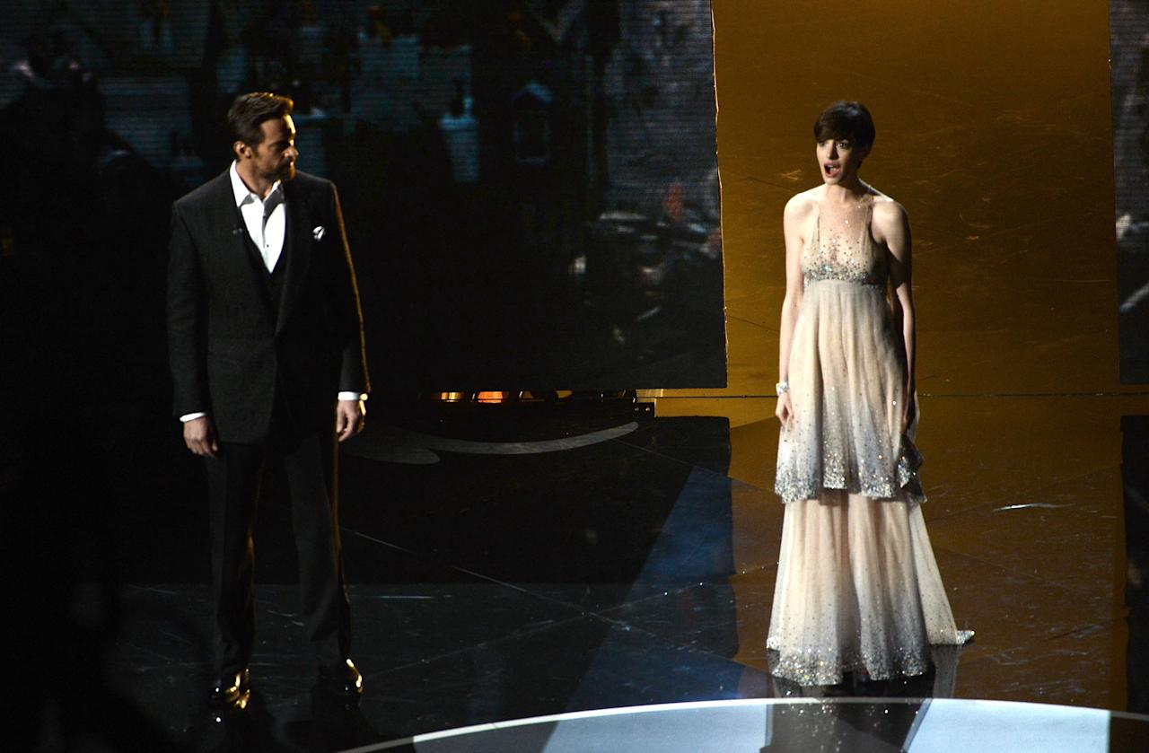 HOLLYWOOD, CA - FEBRUARY 24:  Actor Hugh Jackman and actress Anne Hathaway perform onstage during the Oscars held at the Dolby Theatre on February 24, 2013 in Hollywood, California.  (Photo by Kevin Winter/Getty Images)
