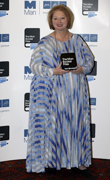 Hilary Mantel, winner of the Man Booker Prize for Fiction, poses with her prize for the photographers shortly after the award ceremony in central London, Tuesday, Oct. 16, 2012. Mantel, won the 50,000 British pounds (80,000 US dollars) prize with her book 'Bring up the Bodies'. (AP Photo/Lefteris Pitarakis)