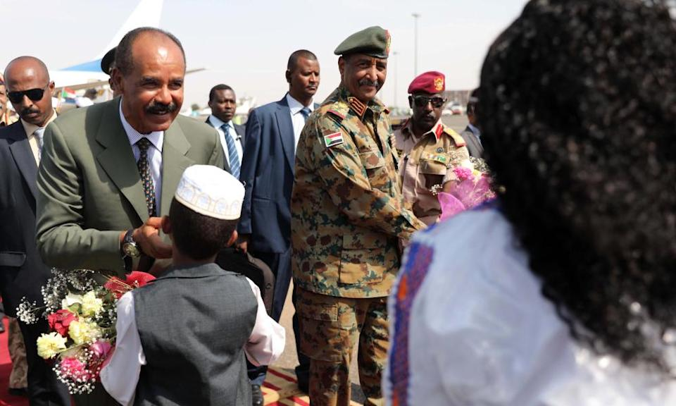 Eritrea's president, Isaias Afewerki, is greeted at Khartoum airport on a visit to Sudan.