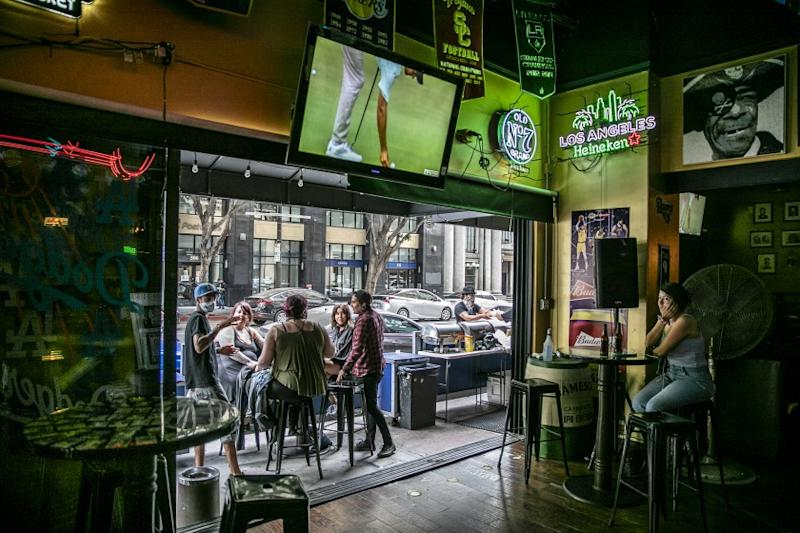 Los Angeles, CA, Sunday, June 28,2020 - Patrons of the Down'n'Out Sports Bar, drink at an outside patio. Governor Newsom orders bars to close as Covid-19 cases surge in California. (Robert Gauthier / Los Angeles Times)