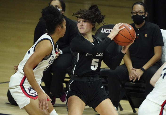 Providence guard Kyra Spiwak (5) looks for an opening against Connecticut guard Evina Westbrook (22) in the second half of an NCAA college basketball game at Harry A. Gampel Pavilion, Saturday, Jan. 9, 2021, in Storrs, Conn. (David Butler II/Pool Photo via AP)