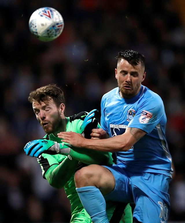 "Soccer Football - League Two Play Off Semi Final Second Leg - Notts County vs Coventry City - Meadow Lane, Nottingham, Britain - May 18, 2018 Notts County's Adam Collin in action with Coventry City's Marc McNulty Action Images/Carl Recine EDITORIAL USE ONLY. No use with unauthorized audio, video, data, fixture lists, club/league logos or ""live"" services. Online in-match use limited to 75 images, no video emulation. No use in betting, games or single club/league/player publications. Please contact your account representative for further details."