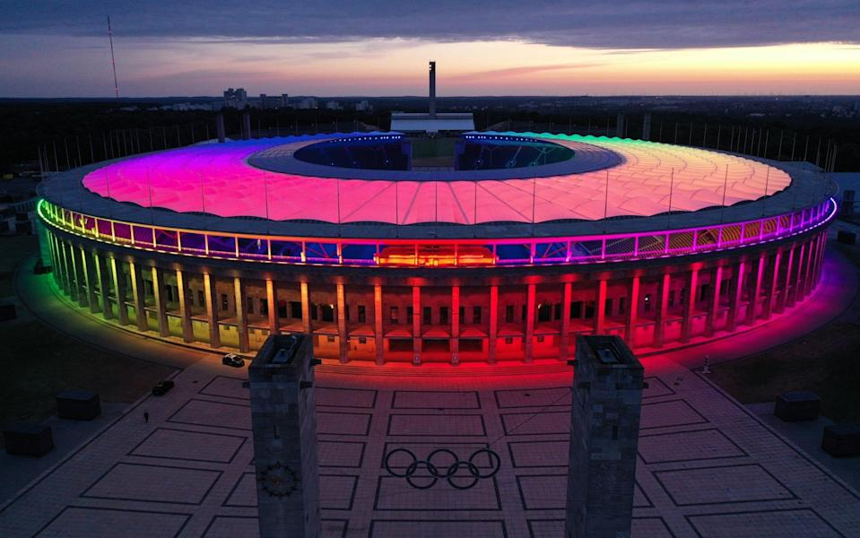 In this aerial view the Olympiastadion stadium stands illuminated in LGBT rainbow colors on June 23, 2021 in Berlin - GETTY IMAGES