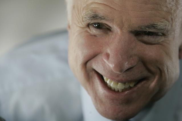 <p>Republican presidential candidate Sen. John McCain smiles as he speaks to reporters aboard his campaign plane en route from Jackson, Miss., to Washington, March 31, 2008. (Photo:Mary Altaffer/AP) </p>