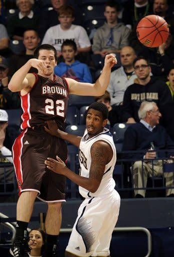 Brown guard Sean McGonagill, middle, passes around Notre Dame guards Pat Connaughton, left and Eric Atkins in the first half of an NCAA college basketball game on Saturday, Dec. 8, 2012 in South Bend, Ind. (AP Photo/Joe Raymond)