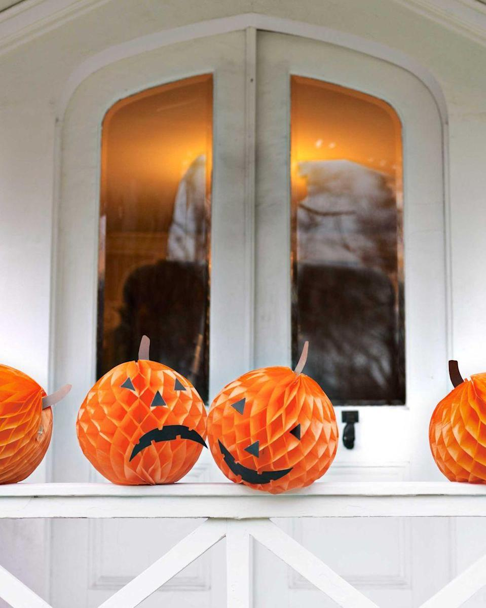"""<p>Orange tissue paper balls can become fun jack-o'lanterns in an instant. Use black construction paper to cut their facial features and stems. </p><p><a class=""""link rapid-noclick-resp"""" href=""""https://go.redirectingat.com?id=74968X1596630&url=https%3A%2F%2Fwww.orientaltrading.com%2Ftissue-balls-orange-a2-3_3112.fltr&sref=https%3A%2F%2Fwww.goodhousekeeping.com%2Fholidays%2Fhalloween-ideas%2Fg33437890%2Fhalloween-table-decorations-centerpieces%2F"""" rel=""""nofollow noopener"""" target=""""_blank"""" data-ylk=""""slk:SHOP TISSUE PAPER BALLS"""">SHOP TISSUE PAPER BALLS</a></p>"""