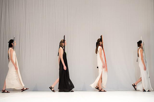 The models walking out to take their places.