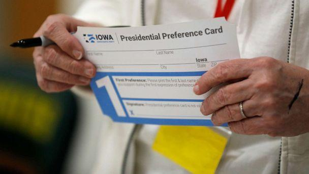 PHOTO: A volunteer holds a Presidential Preference Card before the start of a Democratic caucus at Hoover High School, Feb. 3, 2020, in Des Moines, Iowa. (Charlie Neibergall/AP)