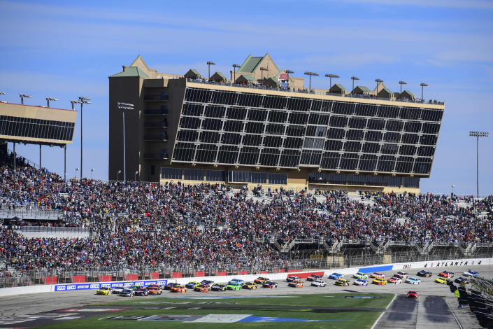 FILE - In this Feb. 24, 2019, file photo, a NASCAR Monster Energy NASCAR Cup Series auto race starts at Atlanta Motor Speedway in Hampton, Ga. NASCAR and IndyCar have each called off their races this weekend. NASCAR was scheduled to run Sunday at Atlanta Motor Speedway without spectators but said Friday, March 13, 2020, it is calling off this weekend and next week's race at Homestead-Miami Speedway. IndyCar was scheduled to open its season Sunday on the streets of St. Petersburg, Florida, but suspended it's season through the end of April.(AP Photo/Scott Cunningham, File)
