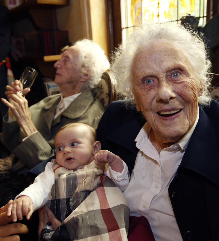 Marie Vaudremer (R), a 100-year-old Belgian twin, holds three-month-old baby Sophie on her knees as she sits next to her twin sister Gabrielle during their birthday party at the Chateau Sous-Bois retirement home in Spa October 2, 2010. Marie and Gabrielle were born in 1910 and are the world's oldest pair of twin sisters, according to the Guinness World Records. REUTERS/Thierry Roge
