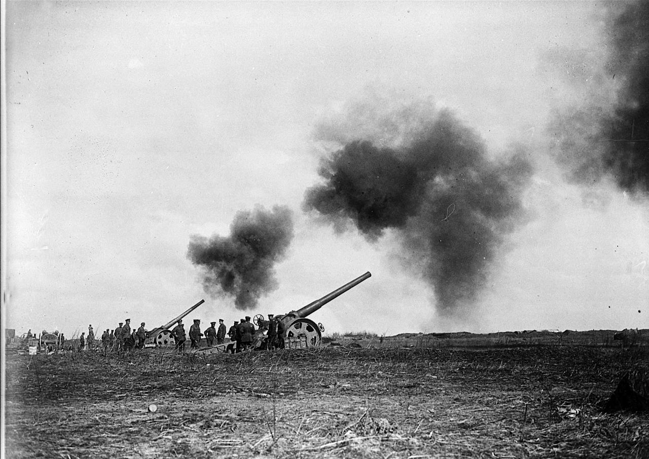 <p>Naval guns fire from behind Canadian positions during the advance on Vimy Ridge in April 1917. Photo from CP. </p>