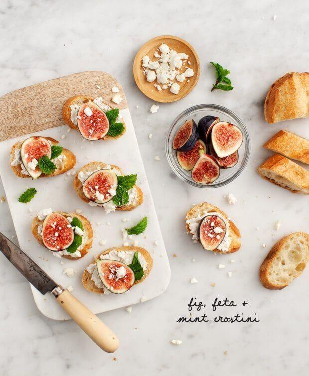 "<p>Top toasted baguette slices with crumbly feta, mint leaves, and fresh figs for a perfect light bite or <a href=""https://www.goodhousekeeping.com/food-recipes/easy/g122/easy-appetizers/"" rel=""nofollow noopener"" target=""_blank"" data-ylk=""slk:party snack"" class=""link rapid-noclick-resp"">party snack</a>. </p><p><a href=""https://www.loveandlemons.com/fig-feta-mint-crostini/"" rel=""nofollow noopener"" target=""_blank"" data-ylk=""slk:Get the recipe from Love & Lemons »"" class=""link rapid-noclick-resp""><em>Get the recipe from Love & Lemons »</em></a> </p>"