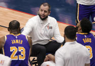 Los Angeles Lakers head coach Frank Vogel talks with his team during a time out in the second quarter of an NBA basketball game against the New Orleans Pelicans in New Orleans, Sunday, May 16, 2021. (AP Photo/Derick Hingle)