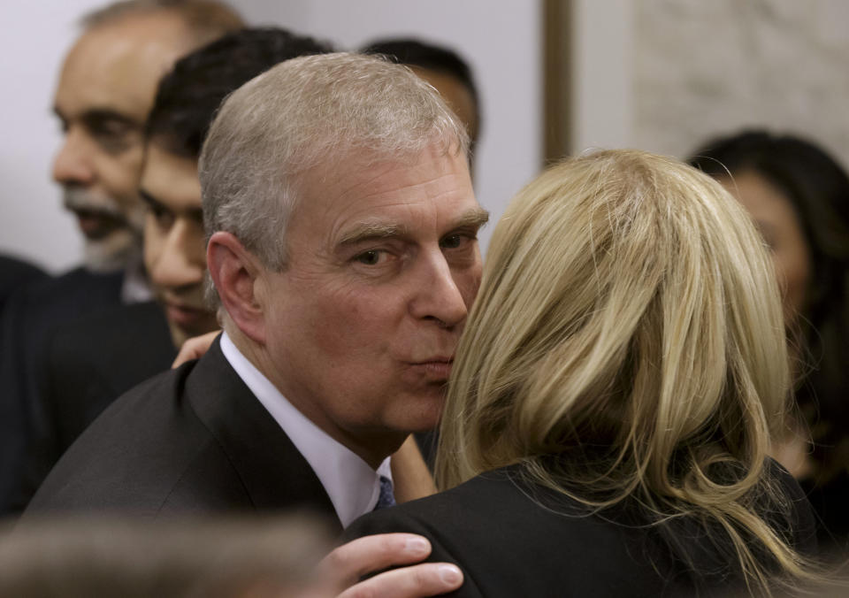 Britain's Prince Andrew greets a business leader during a reception at the sideline of the World Economic Forum in Davos January 22, 2015. Prince Andrew on Thursday made his first public comment on allegations that he had had sex with an underage girl, reiterating previous official denials of the accusations. REUTERS/Michel Euler/Pool (SWITZERLAND - Tags: POLITICS BUSINESS ROYALS)