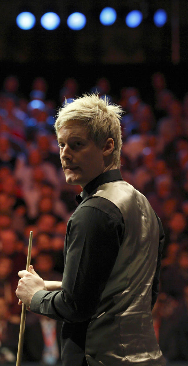 Australia's Neil Robertson lines up a shot during a frame against Shaun Murphy of England during the final of the BGC masters snooker tournament at Alexandra Palace in London on January 22, 2012. AFP PHOTO / JUSTIN TALLIS (Photo credit should read JUSTIN TALLIS/AFP/Getty Images)