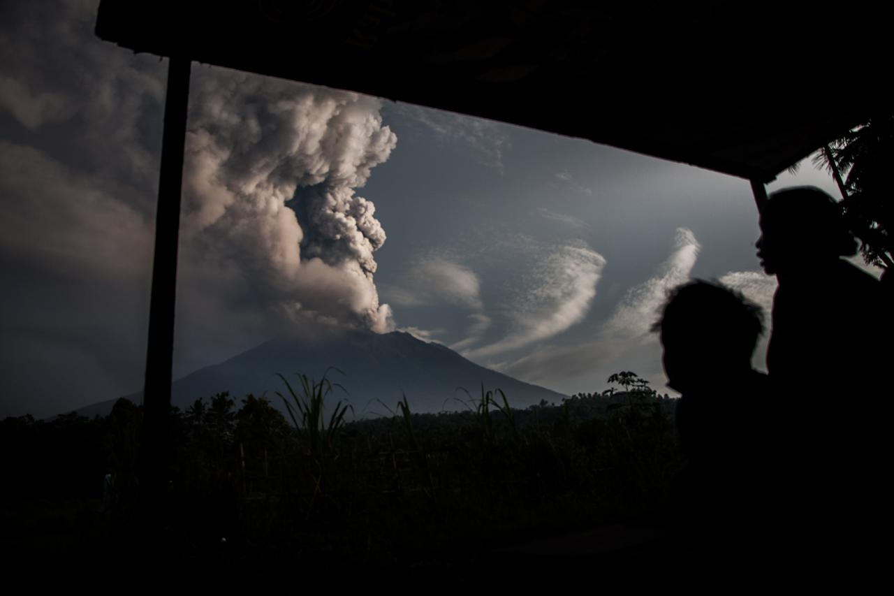 <p>The morning of Mount Agung eruption was seen at Muncan Village on November 28, 2017 in Karangasem regency, Bali, Indonesia. Great volcanic activity in lifting back to level IV by volcanology center and geological hazard mitigation (PVMBG). Lava cool down quickly, bali service in closed temporarily due to the impact of the eruption of volcano Agung. (Photo: Muhammad Fauzy/NurPhoto via Getty Images) </p>